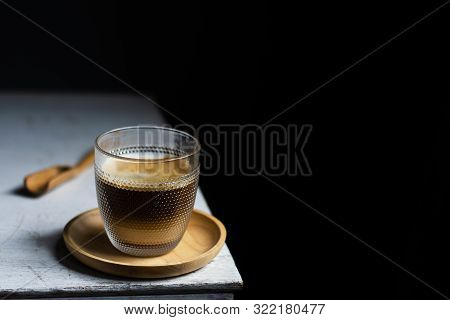 Cup Of Coffee On White Table In Cafe Shop