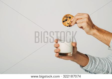 The Guy Is Preparing A Treat For Santa Claus. Snack For The New Year. A Glass Of Fresh Natural Milk