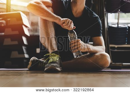 Muscular Caucasian Young Handsome Man Taking A Break Relax And Drinking Water While Resting After Wo