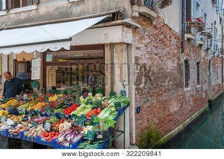 Venice, Italy - September 27, 2013: Fresh Produce Shop With Vegetables And Fruits On Display On Stre