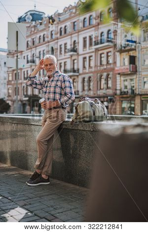 Mirthful Man In The Street With Coffee And Bag Stock Photo
