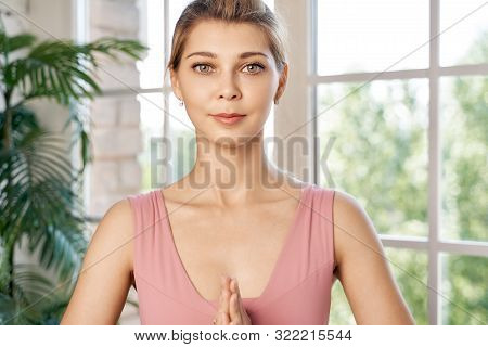 Woman Holding Her Hands Together In Amen Gesture