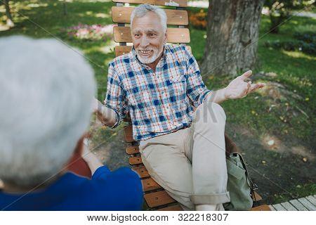 Mirthful Mature Man Spreading His Hands Stock Photo