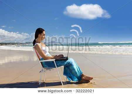 Casual Worker Works With Laptop At Beach