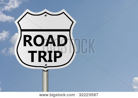 An American interstate road sign with words Road Trip with sky background Taking a Road Trip poster