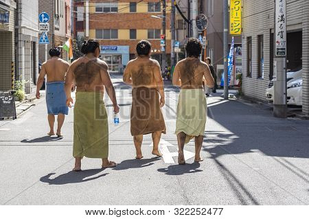 Tokyo, Japan - October 7, 2018. Japanese Sumo Wrestlers Are Having A Walk On A Street After Their Tr