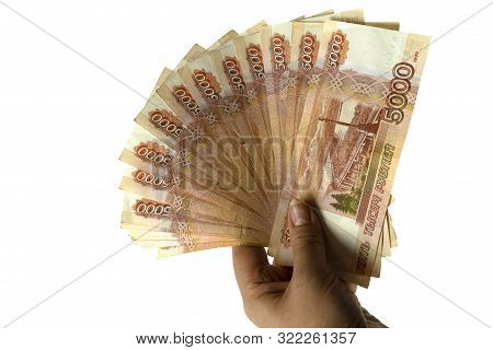 Banknotes Five Thousand Rubles In A Fan In A Hand. On A White Isolated Background Paper Money Of Rus