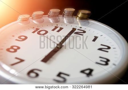 Saving Money. Financial Report. Time Is Money And Wealth. Concept Of Time And Money. 6 O'clock. Phot