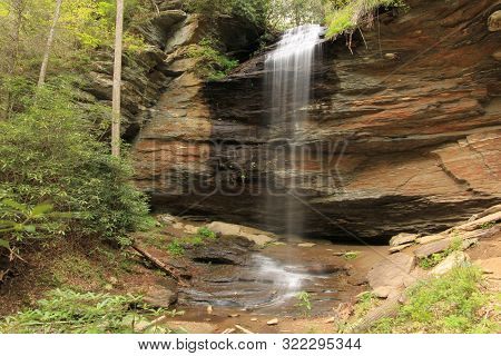 Waterfall Deep Into A  North Carolina Forest With A Rocky Terrain