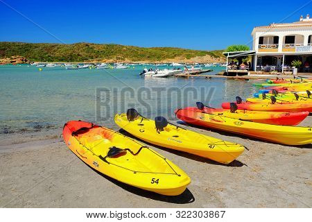 Es Garu, Menorca, Spain - September 4, 2019: View On The Beach Es Grau With Canoes For Tourists On