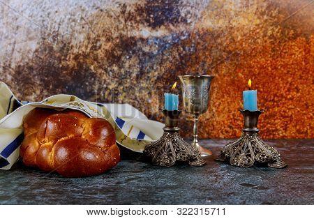 Jewish Holiday Shabbat Eve With Challah Bread, Sabbath Candles And Kiddush Wine Cup.
