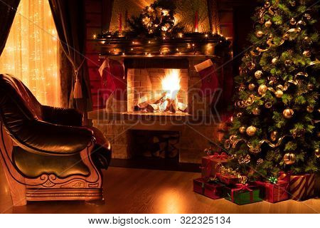 Christmas living room interior with decorated fireplace, armchair and xmas tree