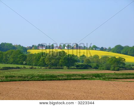 A countryside view of a quintessential English village poster