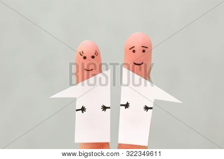 Fingers Art Of Family After Divorce. Concept Of Man And Woman Divided House In Half.