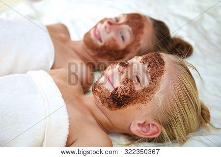 Beautiful Girls With Facial Mask Coffee Scrub.