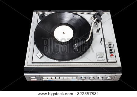 Vintage Record Player With Radio Tuner On Black Background