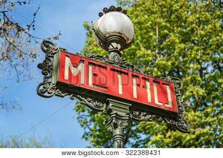 Paris, France, March 30, 2017: Metro subway underground sign Paris France. Paris Metropolitain entrance station. A pole with traditional metro sign