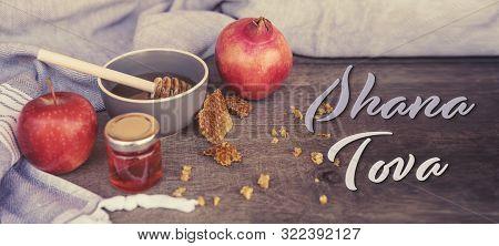 Jewish National Holiday. Rosh Hashana With Honey, Apple And Pomegranate On Wooden Table. Text: Shana