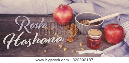 Jewish National Holiday. Rosh Hashana With Honey, Apple And Pomegranate On Wooden Table. Text: Rosh