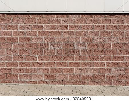 Red Decorative Marble Facing Brick Wall. Background