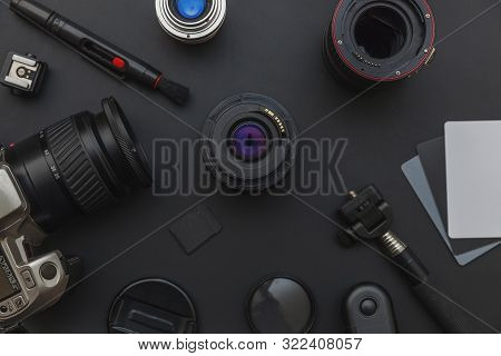 Photographer Workplace With Dslr Camera System, Camera Cleaning Kit, Lens And Camera Accessory On Da