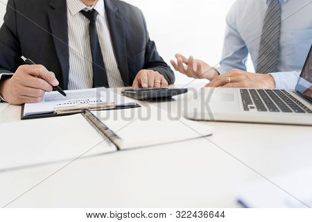 Confident Insurance Agent Broker Man Holding Document And Present Pointing Showing An Insurance Poli