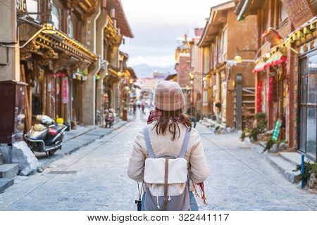 Young Woman Traveler Walking In The Old Town, Shangri-la, Travel Lifestyle Concept