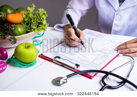 Nutritionist With Healthy Fruit, Vegetable And Measuring Tape Working, Right Nutrition And Diet Conc