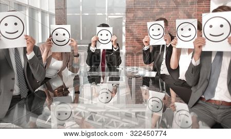 Business Team holding a paper with a positive smiley
