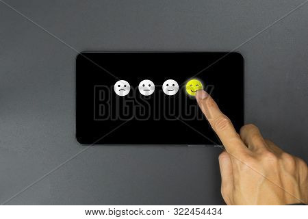Conceptual The Customer Responded To The Survey. The Client Choose A Happy Face Smile Icon On Blackb