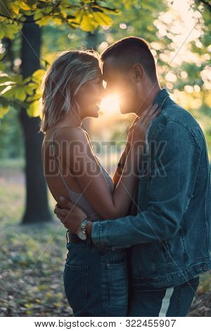 Young Loving Couple Kissing And Enjoying The Company Of Each Other Outdoors. Love, Passion, Dating C
