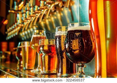 Glasses Of Dark And Light Beer, Ale, Lager, Stout, Porter In Modern And Bright Neon Light With Pouri