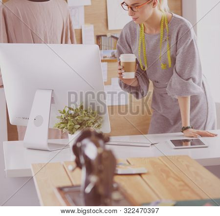 Fashion designer woman sewing with sewing machine