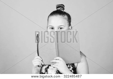 Child Cute Girl Hold Notepad Or Diary Blue Background. Childhood Memories. Diary For Girls Concept.