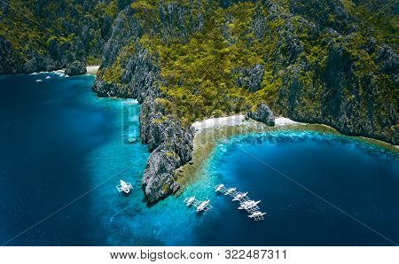 El Nido, Palawan, Philippines. Aerial View Of Miniloc Island With Diving Boats Above Coral Reef Surr