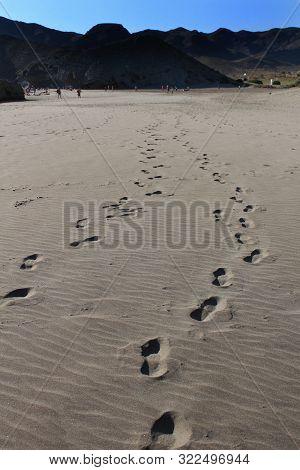 Footprints In The Sand On Cabo De Gata Beach In Almeria, Spain