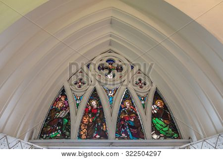 Singapore - March 20, 2019: Inside White Historic Saint Andrews Cathedral. Stained Glass Windows Fea