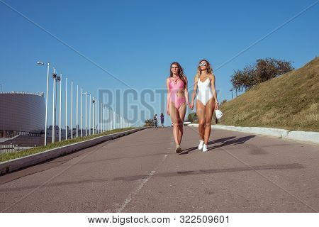 Two Girls Girlfriends Women Walk In City, Sunbathe Swimsuits, Sunglasses, Youth Lifestyle Healthy Hi