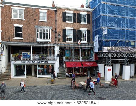 Chester, Cheshire, United Kingdom - 7 September 2019: People Walking Along Watergate Street Past Caf