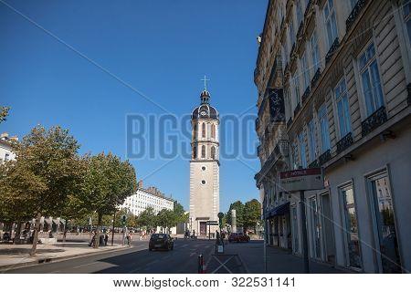 Lyon, France - July 19, 2019: Clocher De La Charite Clocktower On The Place Bellecour Square In Summ