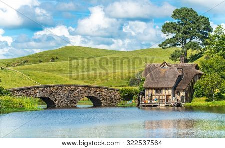 Matamata, New Zealand - December 09 2017 : The Scenery View Of Hobbiton Mill And Double-arched Bridg