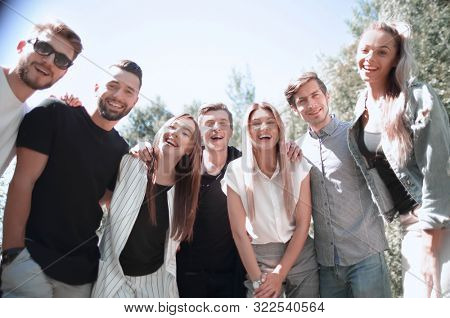 group of happy young people outdoors