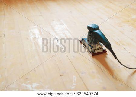 wooden floor sanding with flat sander tool poster
