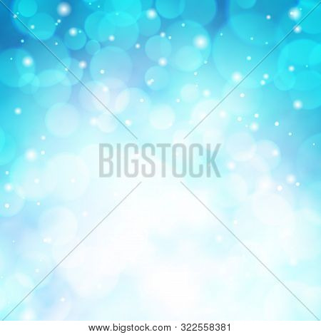 Beautiful Blurred Blue Background With Bokeh. Winter Sky With Snowfall Glitter Lights Backdrop. Merr