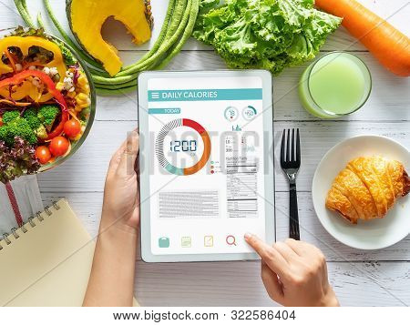 Calories Counting , Diet , Food Control And Weight Loss Concept. Woman Using Calorie Counter Applica