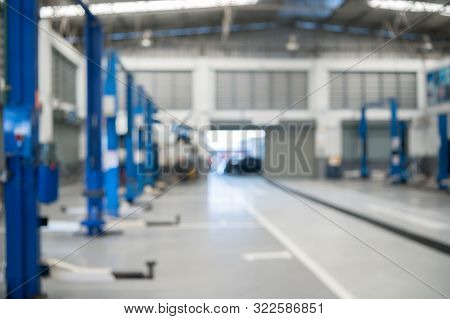 Blurred Background Of Repairing Garage With No People. Blurry Mechanics Workshop Car Station And Veh