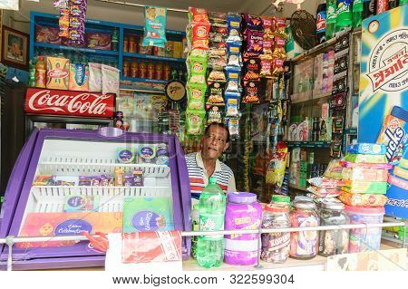 Kolkata, West Bengal, India 1st January, 2019 - A Retail Grocery Shop Owner Looking For Customer Fro
