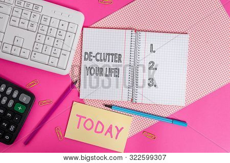 Writing note showing De Clutter Your Life. Business photo showcasing remove unnecessary items from untidy or overcrowded places Writing equipments and computer stuffs placed above colored plain table. poster