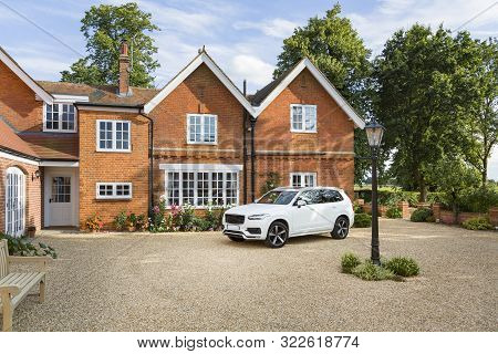 Large Executive Mansion House And Luxury Car In A Rural Setting, Buckinghamshire, England, Uk