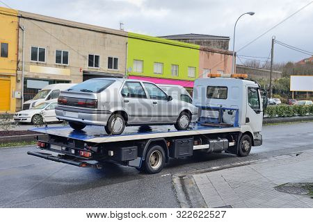 Image Of Tow Truck With A Car On The Road